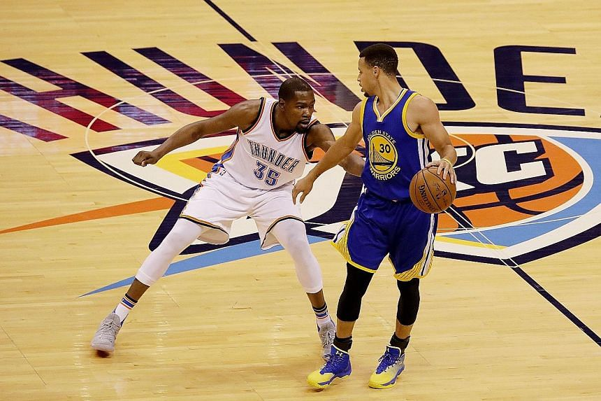 Golden State's Stephen Curry (right) and Oklahoma City's Kevin Durant facing off in Game 3 of the Western Conference Finals. The former rivals will become team-mates after Durant signed a two-year deal worth US$54.3 million (S$73.2 million).