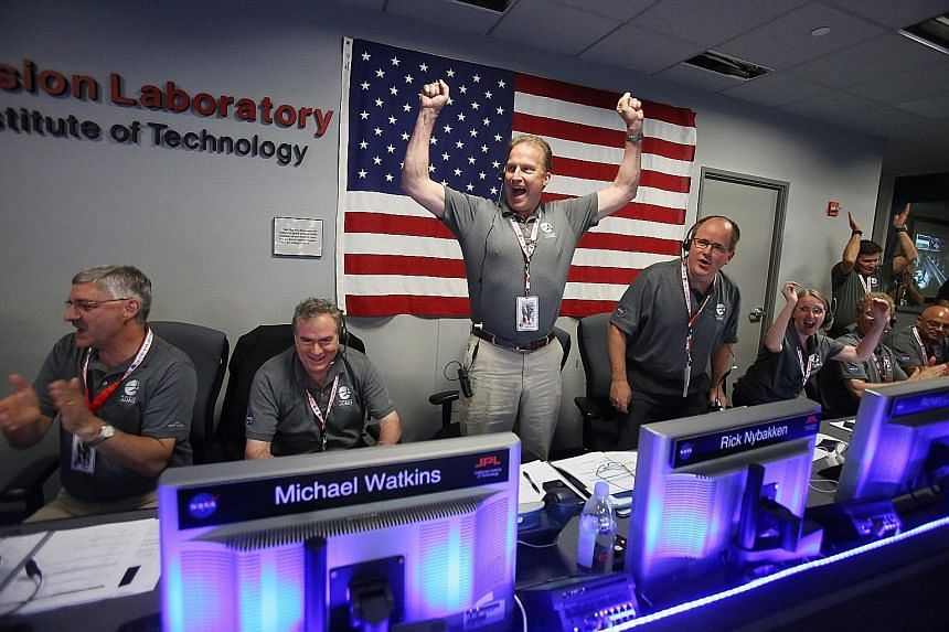 Nasa scientists behind the Juno project cheering as the solar-powered spacecraft went into orbit around Jupiter yesterday. It has taken five years for Juno to travel this far, and its inaugural lap around the solar system's most massive planet will l
