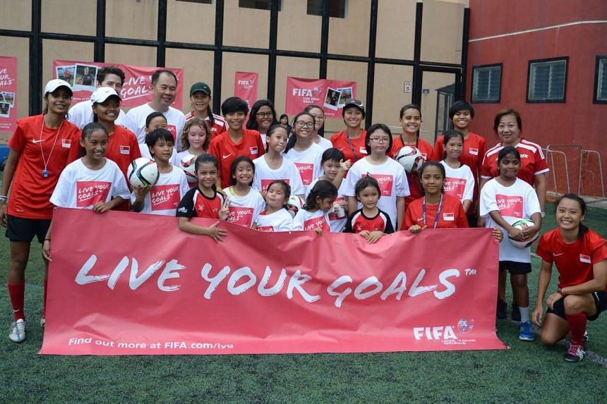 """Participants at the first Fifa """"Live Your Goals"""" Festival in Singapore posing for a picture at Queensway Secondary School on May 21, 2016."""