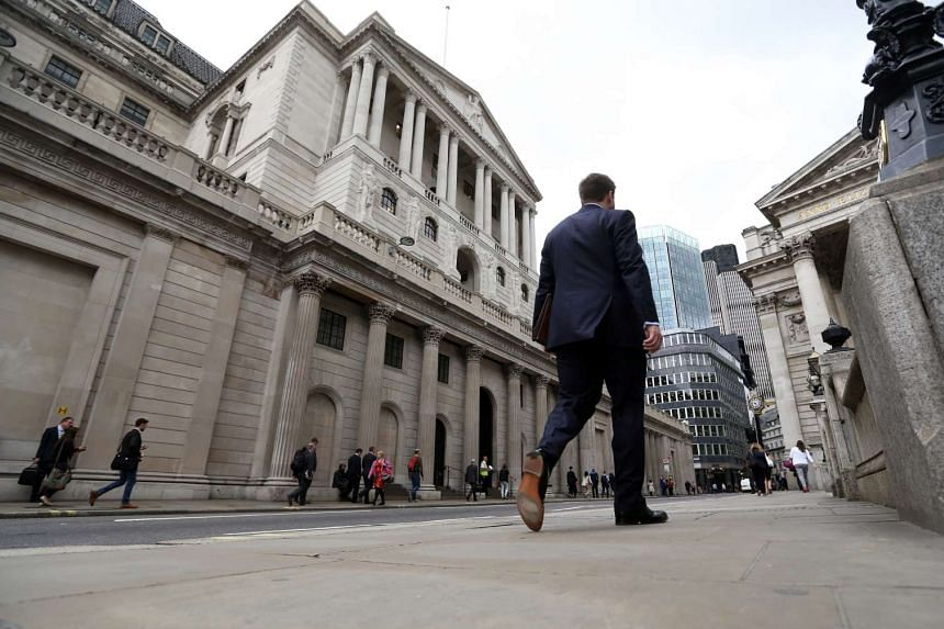 Pedestrians walk past the Bank of England on Tuesday, July 5, 2016.