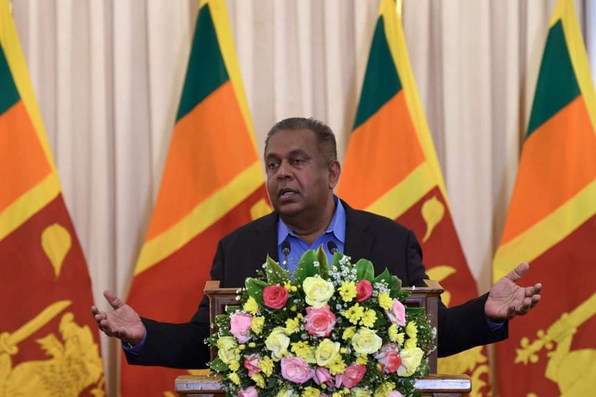 Sri Lankan Foreign Minister Mangala Samaraweera addresses reporters after attending the United Nations Human Rights Council, in Colombo on June 6, 2016.