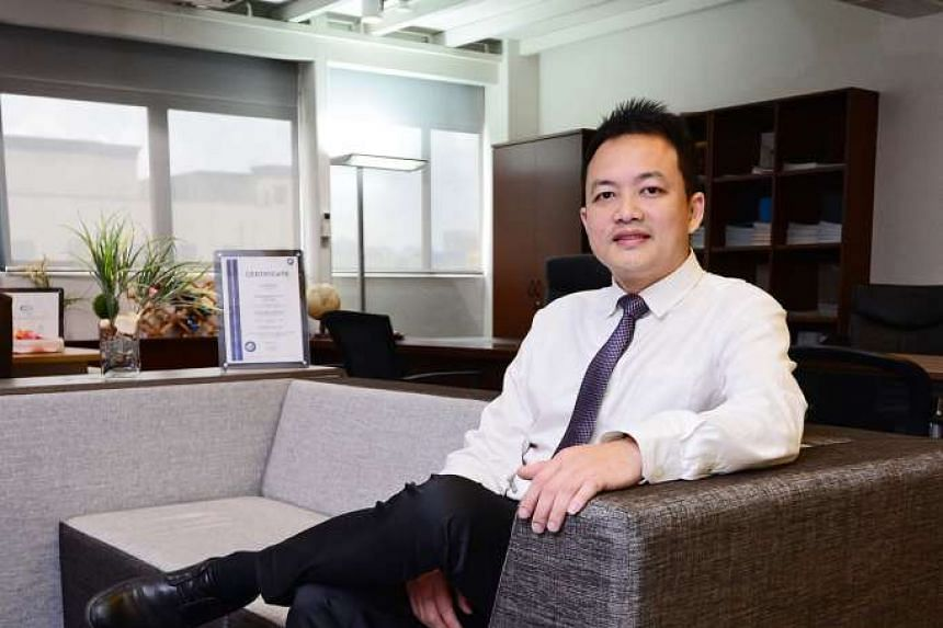 """Mr Alan Ng in his company's showroom in Pasir Panjang. """"Our new direction is to create furniture that is open- concept, boosts interaction, and is eco-friendly,"""" he says."""