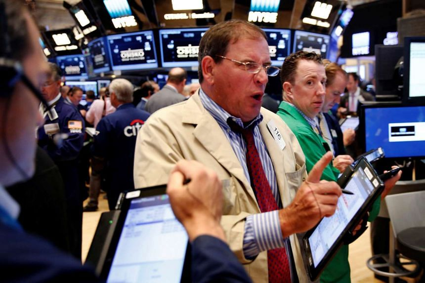 Traders work on the floor of the New York Stock Exchange shortly after the opening bell on July 6, 2016.