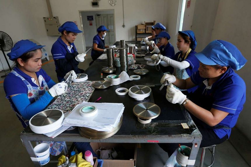 Employees arrange blades at an assembly line at Gang Yan Diamond Tools in the Thai-Chinese Rayong Industrial Zone, Thailand, on April 7, 2016.