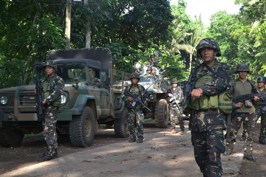 Philippine soldiers patrolling along a highway in Indanan town, Sulu province, on June 14, 2016.