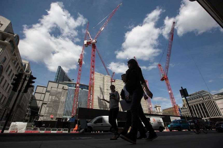Construction cranes operate on a building site in London, UK, on July 6.