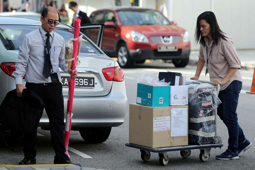 CID officers bringing documents related to the case to court on Thursday (July 7).