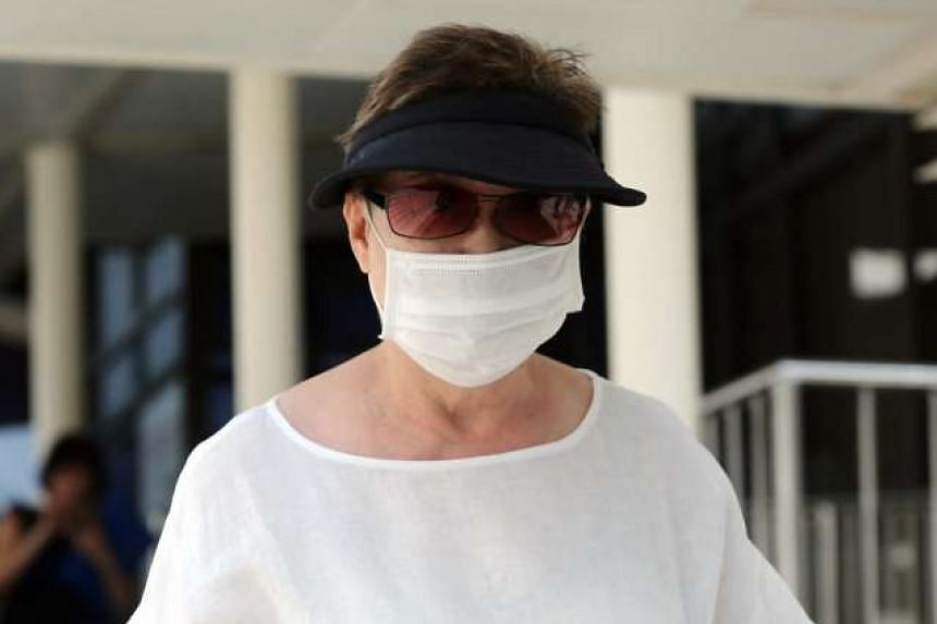 Madam Tan Hoon Choo, Mark Tan's paternal aunt, seen leaving the State Courts on Thursday (July 7).
