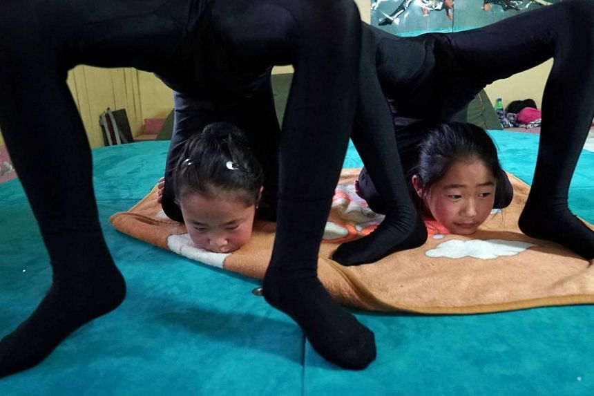 Young contortionists practice at a training school in Ulaanbaatar, Mongolia, on July 4.