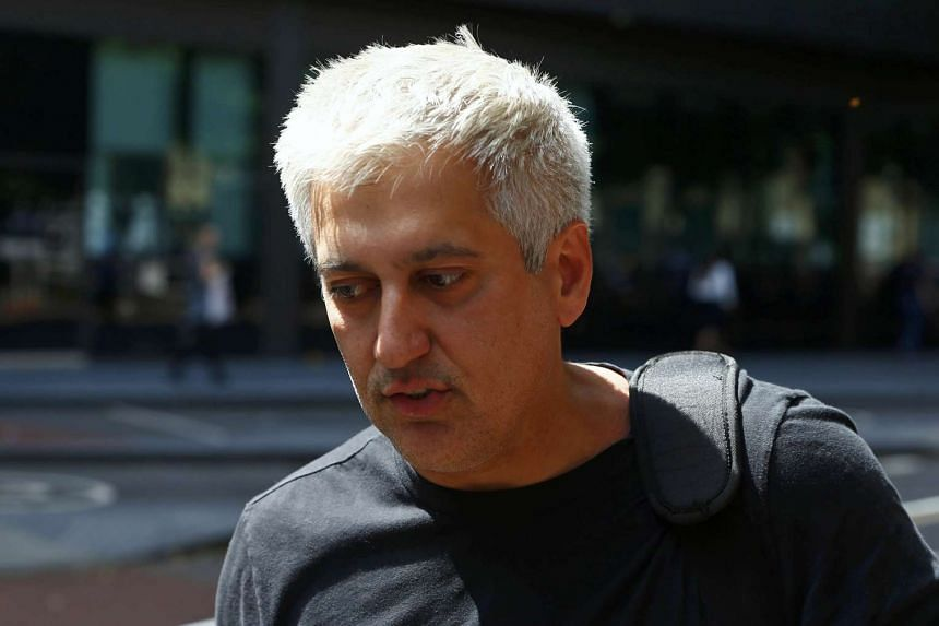 Former Barclays trader Jay Merchant arrives for sentencing at Southwark Crown Court in London, on July 7, 2016.