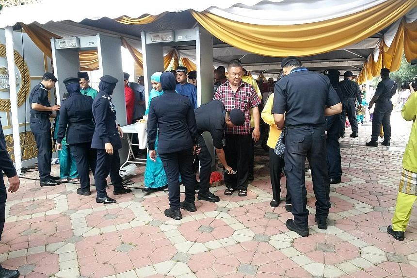 Guests at Prime Minister Najib Razak's annual Aidilfitri open house yesterday morning had to undergo two security checks as they entered the Seri Perdana compound. Since ISIS first issued threats against Malaysia's leaders and high-ranking officials