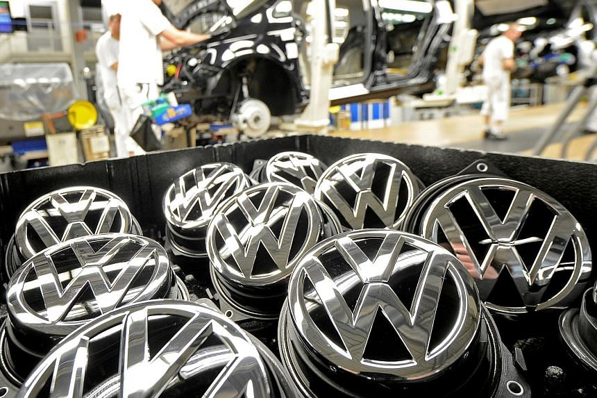 Emblems of the Volkswagen Golf VII car in a production line at a plant in Wolfsburg, Germany. Some 11 million Volkswagen vehicles worldwide were affected by the emissions scandal that broke in October last year.