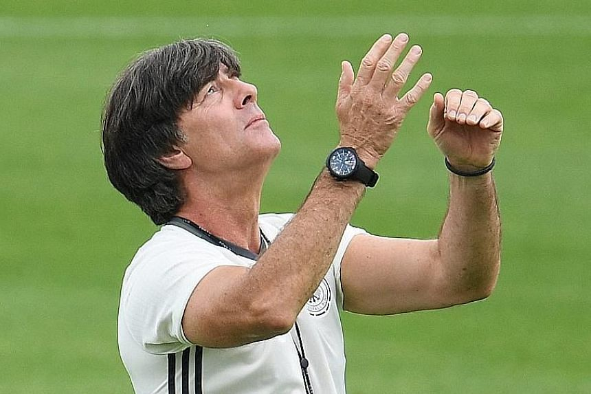 Germany coach Joachim Low, during a training session at his team's camp in Evian, has high hopes for his team. The Germans, three-time champions in this competition, face hosts France in the semi-finals today.