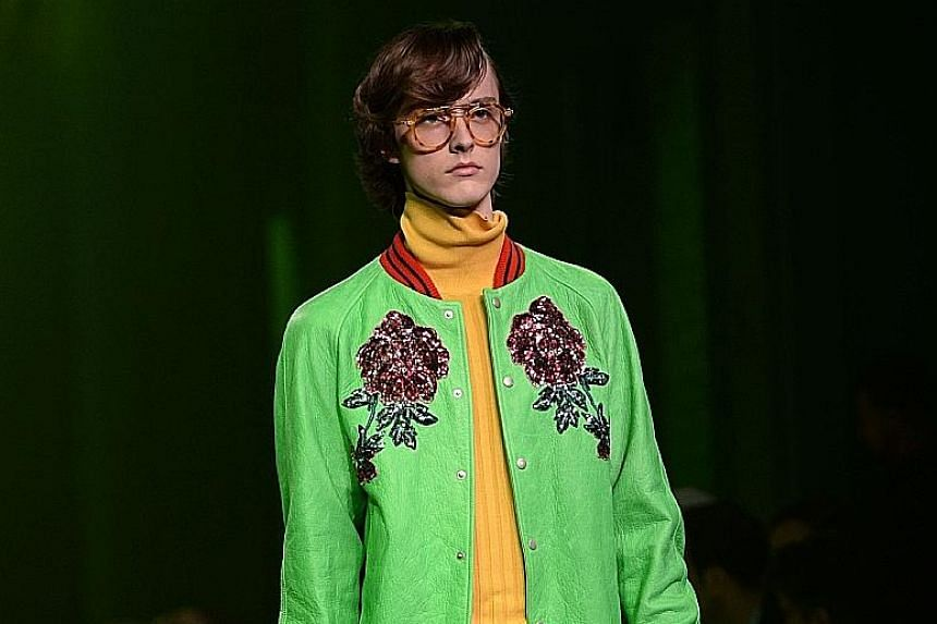 Gucci's signature flower motif on a jacket shown at the men's spring/summer 2017 fashion show in Milan, Italy, last month. A service at the label's flagship store in Milan allows customisation of jackets, tuxedos, coats and shoes.