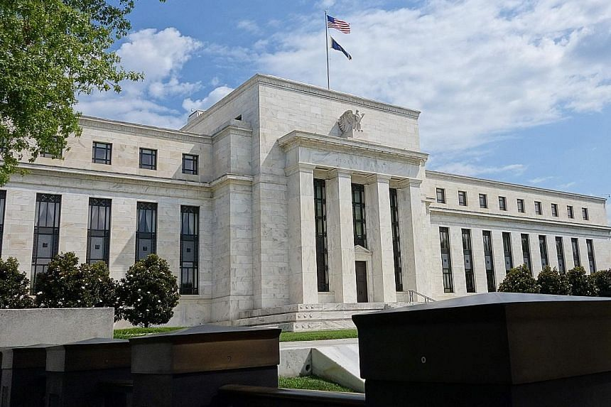 The Federal Reserve building in Washington. Interest rates are likely to stay low with few now expecting the US central bank to hike rates by December, OCBC analyst Andy Wong says.