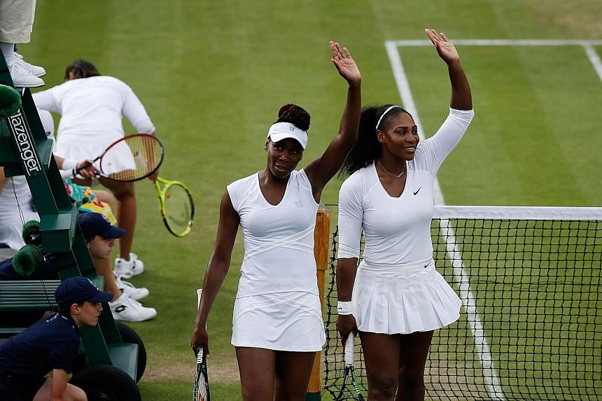 Serena (right) and sister Venus waving after defeating Slovenia's Andreja Klepac and Katarina Srebotnik 7-5, 6-3 in their Wimbledon doubles first-round match. Two more wins later, they are in the last eight.