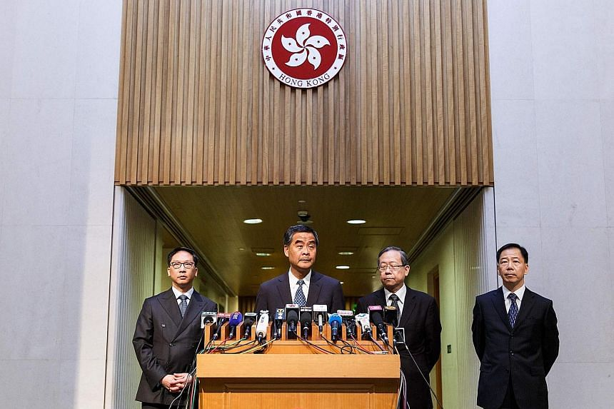 Facing the media yesterday were (from left) Justice Minister Rimsky Yuen, Mr Leung, Security Minister Lai Tung Kwok and acting police commissioner Tony Wong.