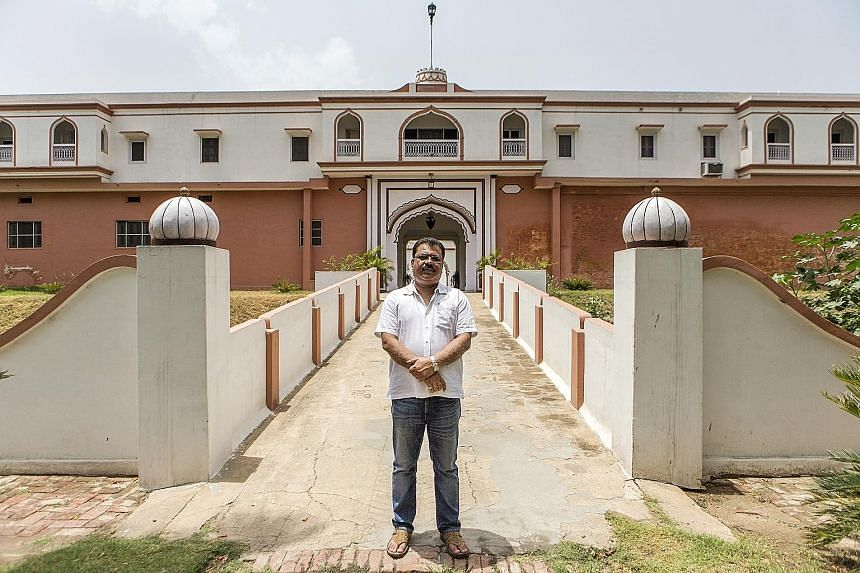Mr Singh outside his mansion in Uttar Pradesh, northern India. He is one of thousands of rich landowners who do not need to pay taxes, thanks to laws that are meant to help the hundreds of millions of poor farmers who eke out a living from India's so