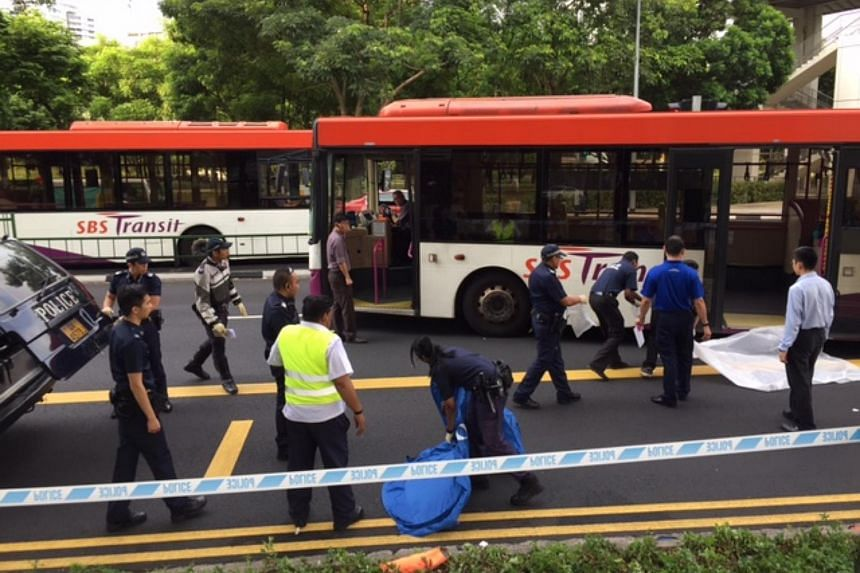 Police officers at the scene of the accident outside Toa Payoh bus interchange.