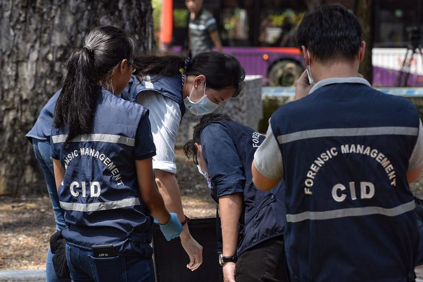 CID officers looking for evidence at the scene of a robbery, at an outlet of Standard Chartered bank in Holland Village, on July 7, 2016.