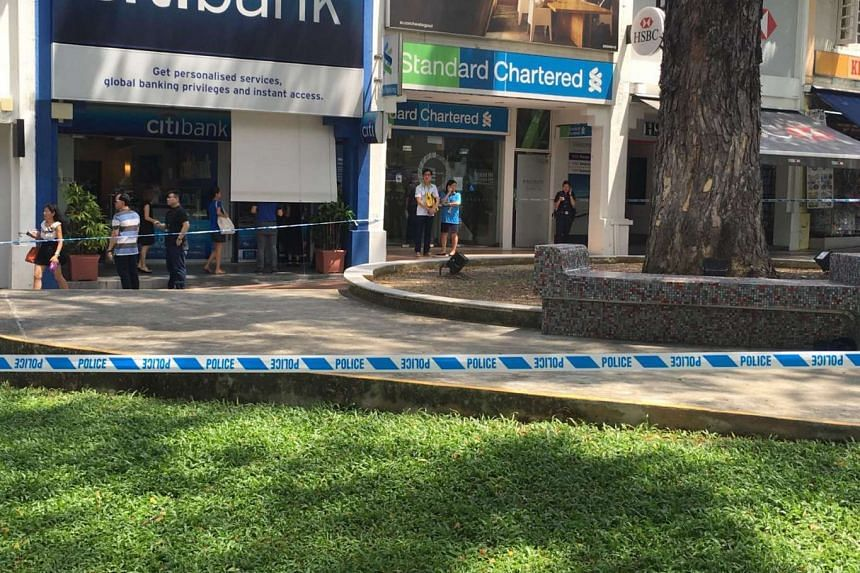 The area surrounding the Standard Chartered bank branch in Holland Village seen cordoned off on Thursday (July 7).