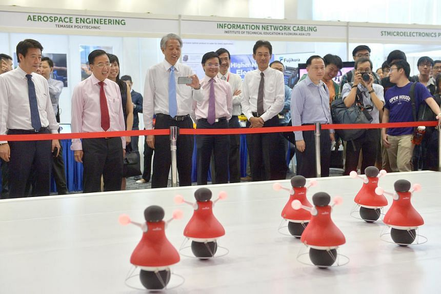 Deputy Prime Minister Teo Chee Hean looks at the robot cheerleader demonstration during the biennial WorldSkills Singapore 2016 competition on July 7, 2016.