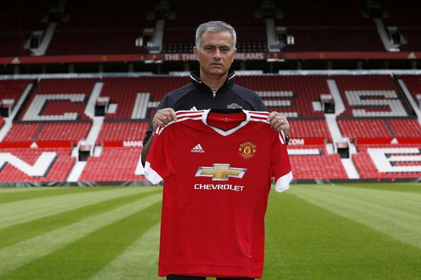 Manchester United manager Jose Mourinho poses ahead of the press conference at Old Trafford.