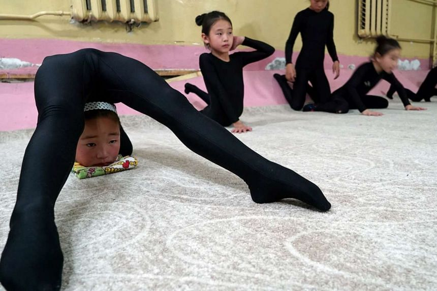 Young contortionists practice at a training school in Ulaanbaatar, Mongolia on July 4, 2016.
