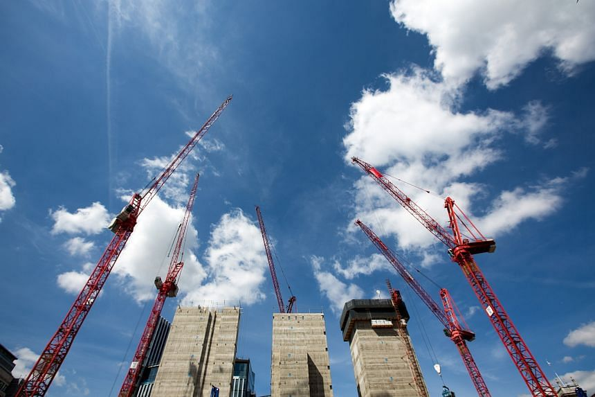 Construction cranes operate on a building site in London on July 6.