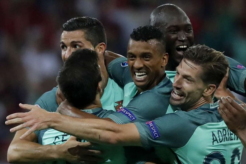 Nani (centre) celebrates with teammates after scoring the 2-0 lead.