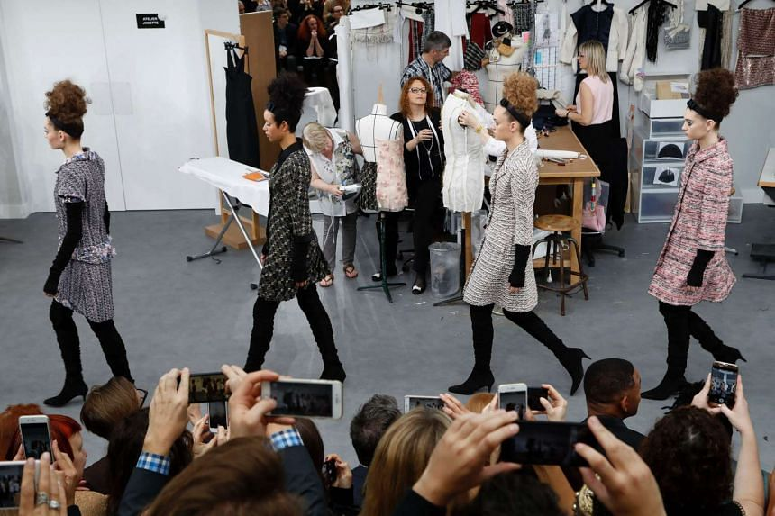 Chanel revealed the secret life of its couture studio on the set of its catwalk (above), with riffs on the classic Chanel box jacket and English model Edie Campbell appearing in the finale.