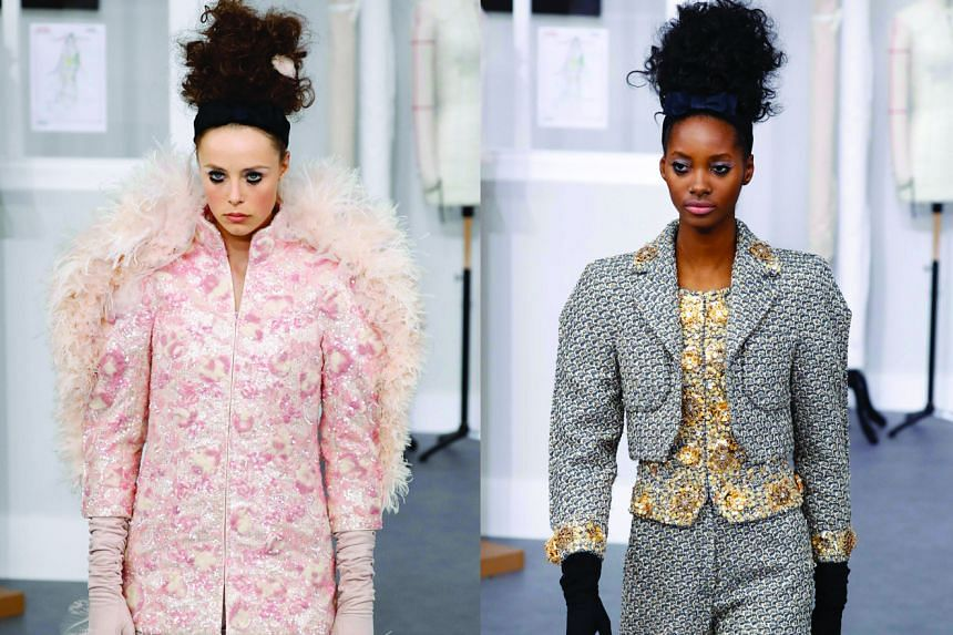 Chanel revealed the secret life of its couture studio on the set of its catwalk, with riffs on the classic Chanel box jacket (right) and English model Edie Campbell (left) appearing in the finale.