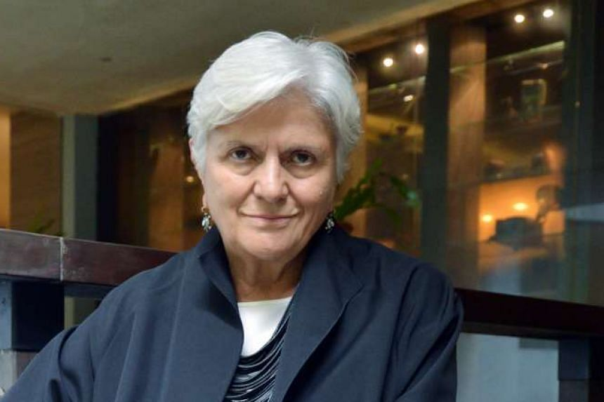 In Singapore, Max Mara's best-selling item is the Max Mara 101801 coat. Its group fashion director Laura Lusuardi (above) has been with the company since 1964.