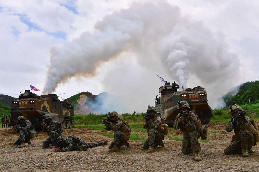 South Korean and US troops taking part in a joint military drill in the South's Pohang port yesterday. A military official said Seoul's move to increase its border propaganda broadcasts is aimed at punishing Pyongyang for its recent series of provoca