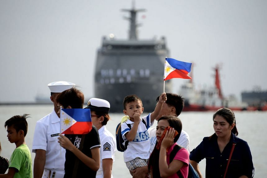 Relatives of the crew of the Philippine navy's BRP Tarlac out to welcome the arrival of the first strategic sealift vessel in Manila in May. The BRP Tarlac will serve as the navy's floating command and control ship as the country modernises its fleet amid