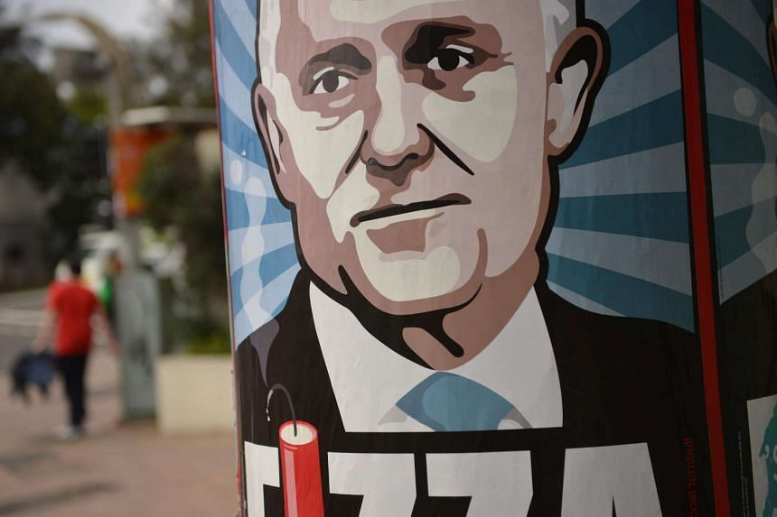 A poster of embattled Australian Prime Minister Malcolm Turnbull created by Sydney artist Michael Agzarian is seen on a street in Sydney.