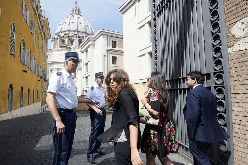 """Public relations expert Francesca Immacolata Chaouqui (centre) arrives for a hearing in the so-called """"Vatileaks II"""" trial in Vatican City on July 4."""