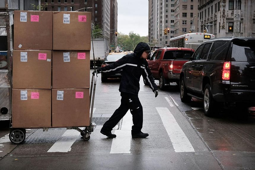 A man delivers boxes in midtown at Rockefeller Centre on May 6, 2016, in New York.