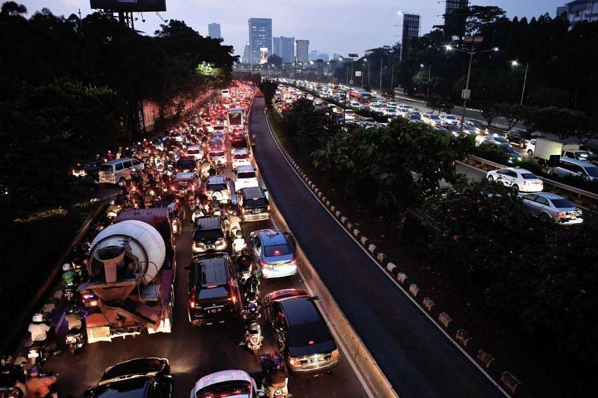 Motorists in a traffic jam on a main road in Jakarta on June 21, 2016, as they return home to break the fast during the month of Ramadan.