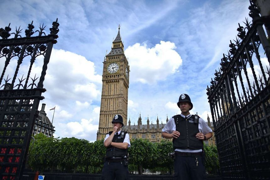Two police officers stands guard at the gates to the Palace of Westminster in central London on June 28, 2016.