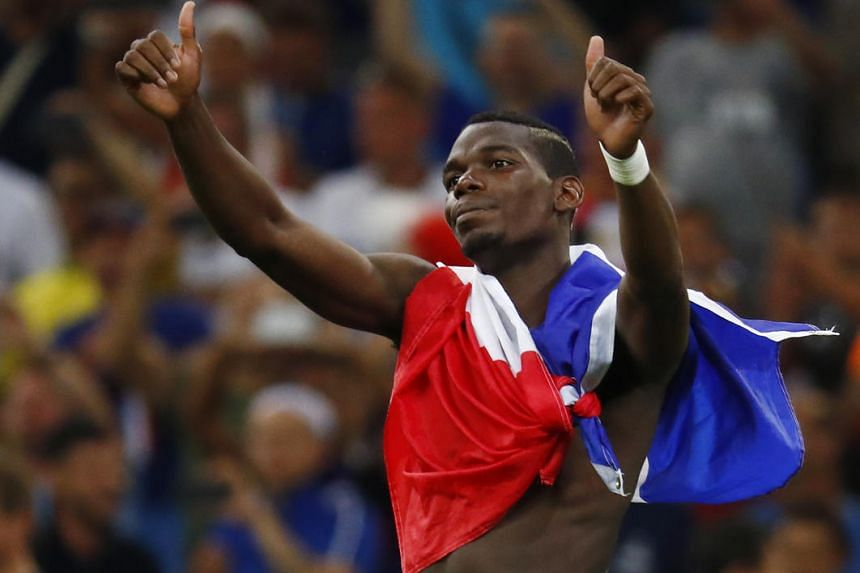France's Paul Pogba celebrates at the end of the Uefa Euro 2016 semi-final match between Germany and France, on July 7, 2016.