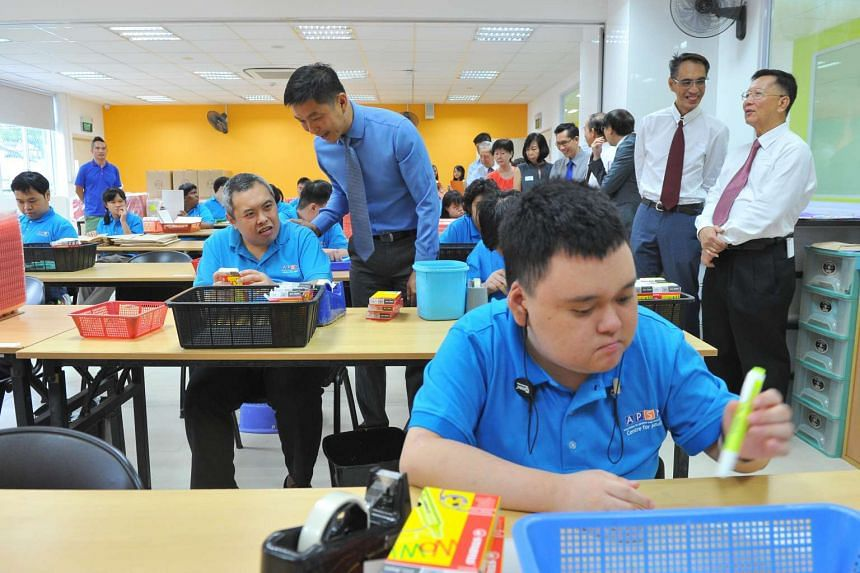 Minister Tan Chuan-Jin interacting with Mr Ang Seow Chuan, 43, client of APSN Centre for Adults, on July 8, 2016.