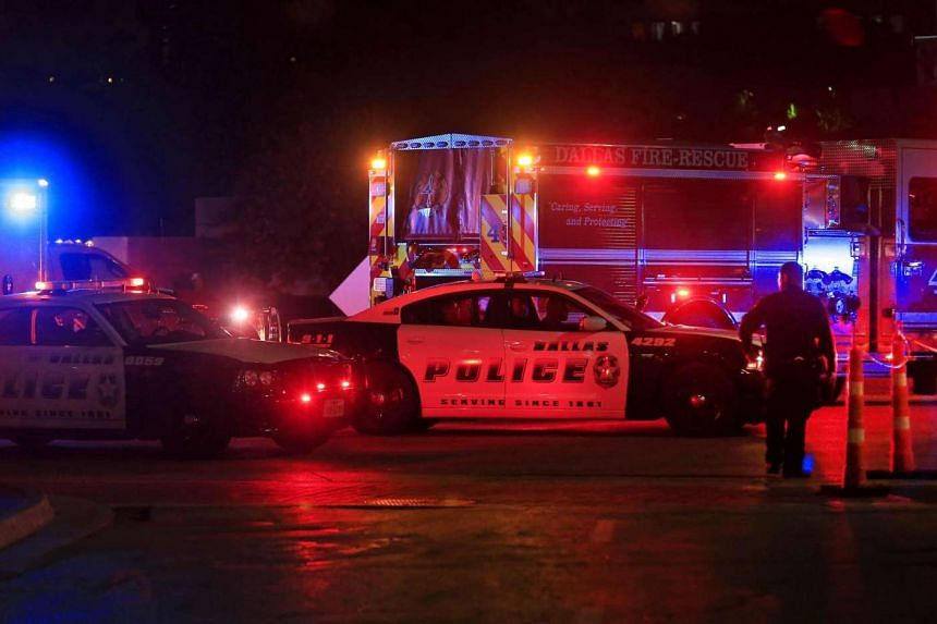 Dallas police work near the scene where 11 Dallas police officers were shot and five have now died, on July 7, 2016.