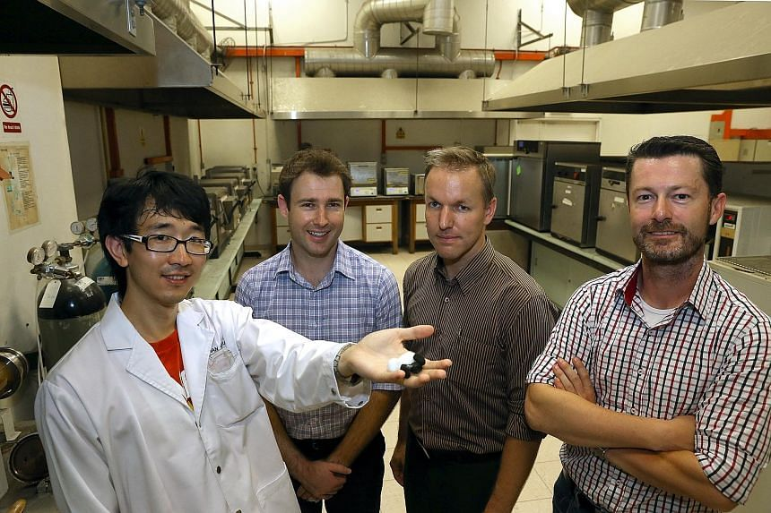 Research fellow Yu Yi Fu (far left), 30, shows a sample of CFA, a product that could make industrial waste management cheaper and more eco-friendly. With him are (from left) EcoWorth Tech programme manager Kim Wimbush, chief operating officer Andre S