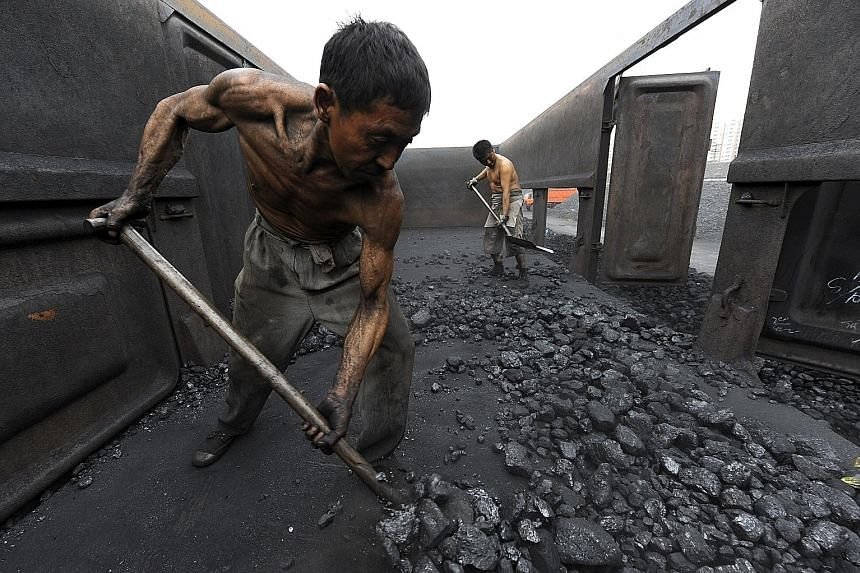 Workers unloading coal in Hefei, in China's Anhui province. Figures show that in 2012, China used the most coal: 47 per cent of the global total. Increased coal use in Asia could cause widespread cooling of the Northern Hemisphere, which could lead t