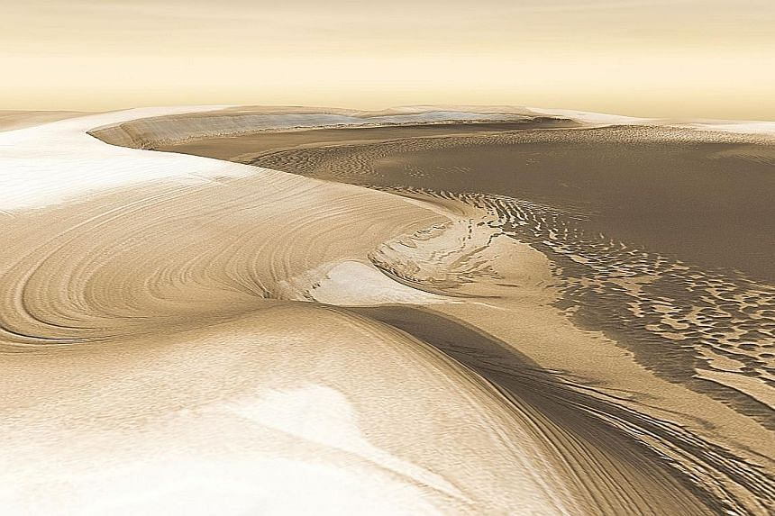 A simulated image from Nasa of Chasma Boreale, a canyon reaching 570km into the north polar cap on Mars. A recent study argues that the discovery of manganese oxide - which forms in wet, oxygen-rich conditions - on Mars' surface suggests the planet w