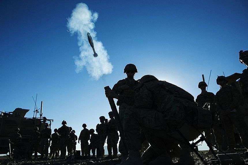 US soldiers conducting a mortar exercise in Afghanistan. American troops will remain in the country for some time still, said Mr Obama, as Afghan forces are still not strong enough to tackle the precarious security situation.