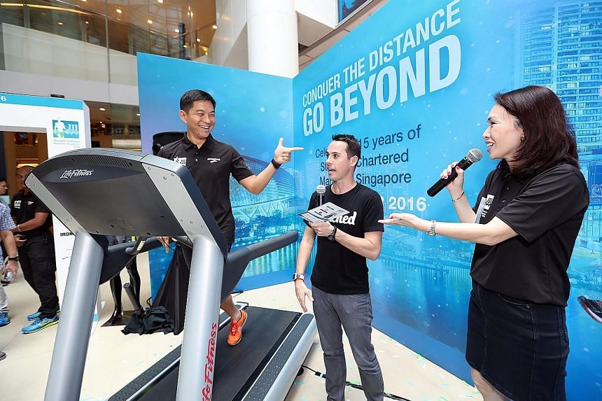 Runners can visit the Standard Chartered Marathon Singapore exhibition to try the fitness test Minister for Social and Family Development Tan Chuan-Jin is seen here running.