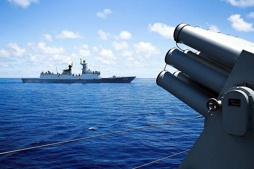 China's South Sea Fleet taking part in a logistics drill near the James Shoal area in the South China Sea in May. The UN-backed Permanent Court of Arbitration will rule next Tuesday in a case the Philippines brought challenging China's claims to most