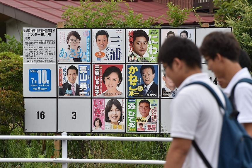 Posters of election candidates put up on a board in Yokohama, ahead of Japan's Upper House election on Sunday. There are concerns of a low turnout, despite a recent rule change allowing Japanese aged 18 and 19 to vote for the first time, adding some
